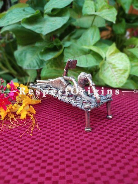 Handmade Brass Figurine Sleeping Landy with Book on Charpai In Dhokra Art; 6 Inches; RespectOrigins.com