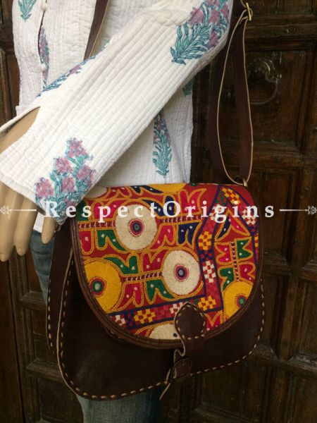 Brown Hand Stitched Cross Ladies Leather Sling Bag; Blue, Pink, White and Yellow On Red Base Kutchi Mirror Embroidery Flap; RespectOrigins.com