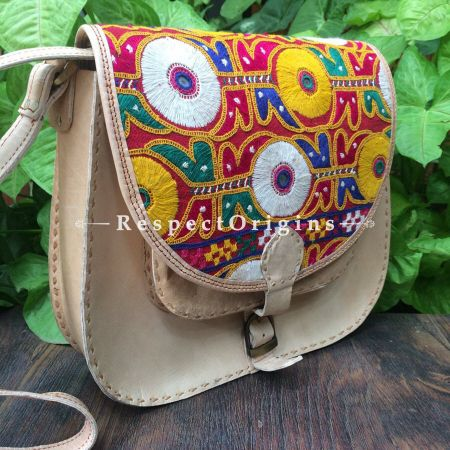 Beige Hand Stitched Cross Ladies Leather Sling Bag; Blue, Green, White and Yellow On Red Base Kutchi Mirror Embroidery Flap; RespectOrigins.com