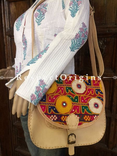 Beige Hand Stitched Cross Ladies Leather Sling Bag; Green, Blue, White and Yellow On Red Base Kutchi Mirror Embroidery Flap; RespectOrigins.com